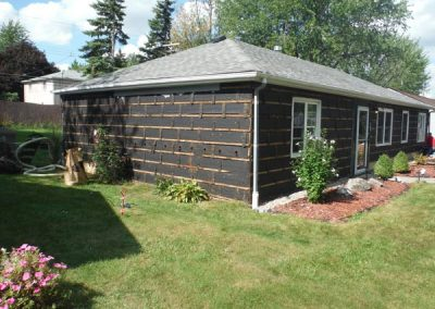 Before siding with stone