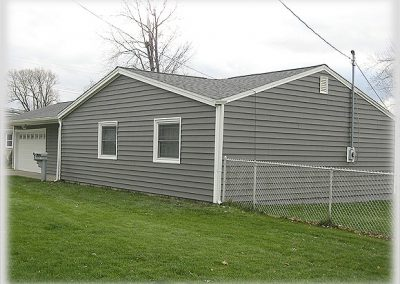 After - Premium siding with dark grey color.