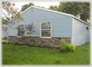 After - siding with stone front